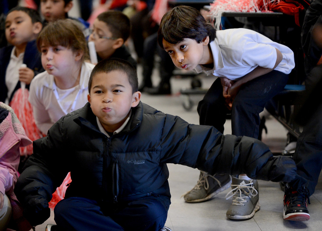 """. Anthony Ybrite, center, Kaitlyn Kimmel, left, and Aadel Saleem give it their best as they blow air to make wind pressure during a \""""Science Rocks\"""" assembly held at El Monte Elementary School in Concord, Calif., on Tuesday, Feb. 26, 2013.  (Susan Tripp Pollard/Staff)"""