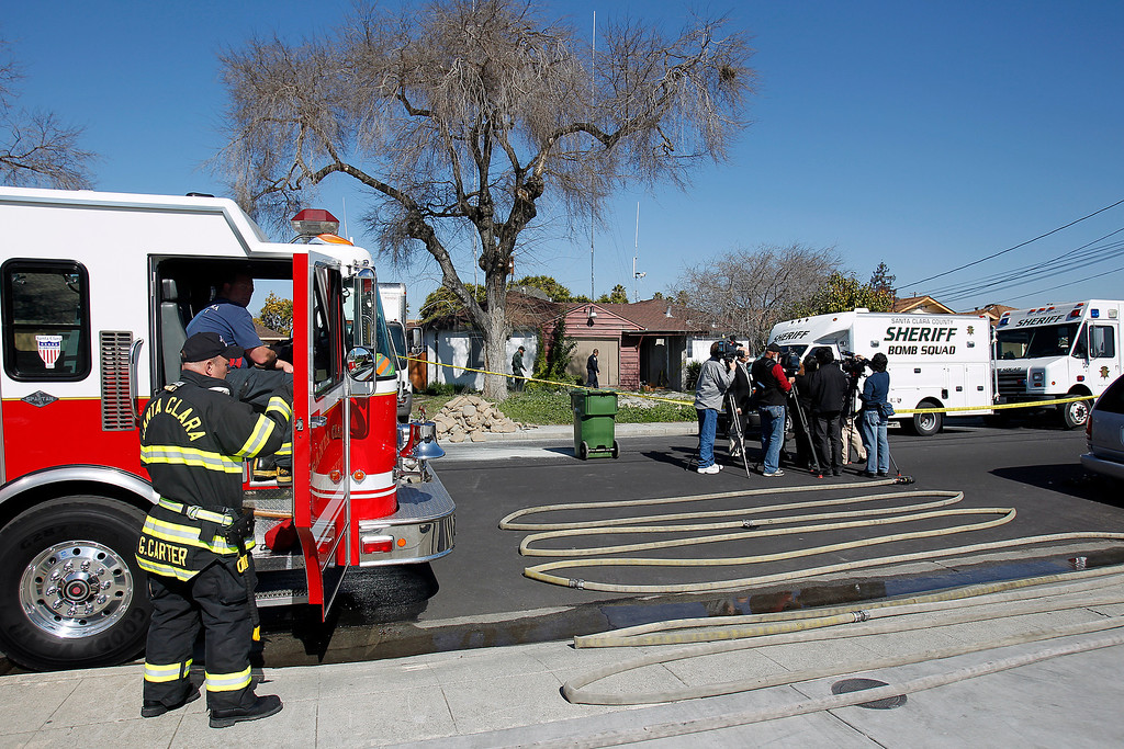 . The Santa Clara County Sheriff\'s Bomb Squad, Santa Clara County Fire Department, and the California Highway Patrol search for explosive materials at Everett Basham\'s house on Humbolt Ave., in Santa Clara, Calif. on Wednesday, Feb. 13, 2013.   (LiPo Ching/Staff)