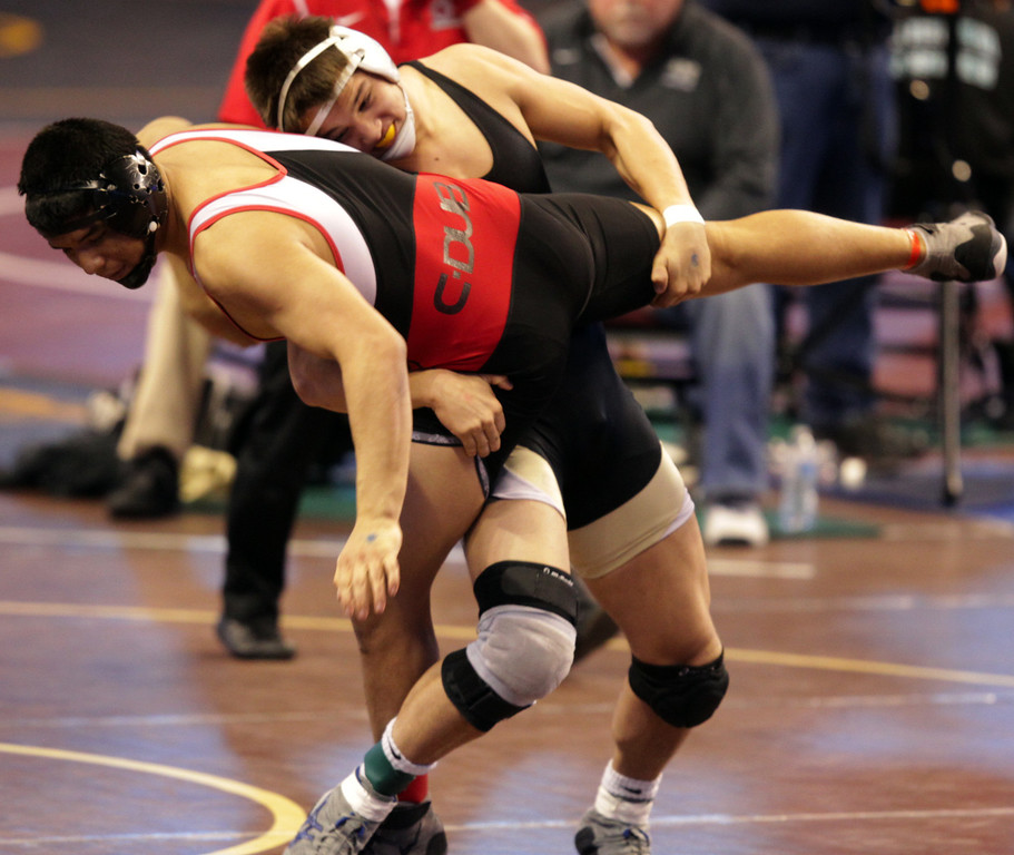 . Archbishop Mitty\'s Chandler Ramirez, right, wrestles Centennial\'s Oscar Martinez in a 195-pound first round match during the California Interscholastic Federation wrestling championships in Bakersfield, Calif., on Friday, March 1, 2013. Ramirez would go onto win the match. (Anda Chu/Staff)
