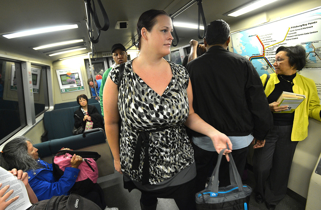 . Lori Myers, of Walnut Creek, exits the BART train at the Embarcadero station on her way to her job in San Francisco, Calif., on Tuesday, July 20, 2013. Myers, a legal secretary by day and dance instructor by night, is one of many Bay Area commuters without the option to telecommute or take advantage of many ride-sharing options if BART goes out on strike. (Dan Rosenstrauch/Bay Area News Group)