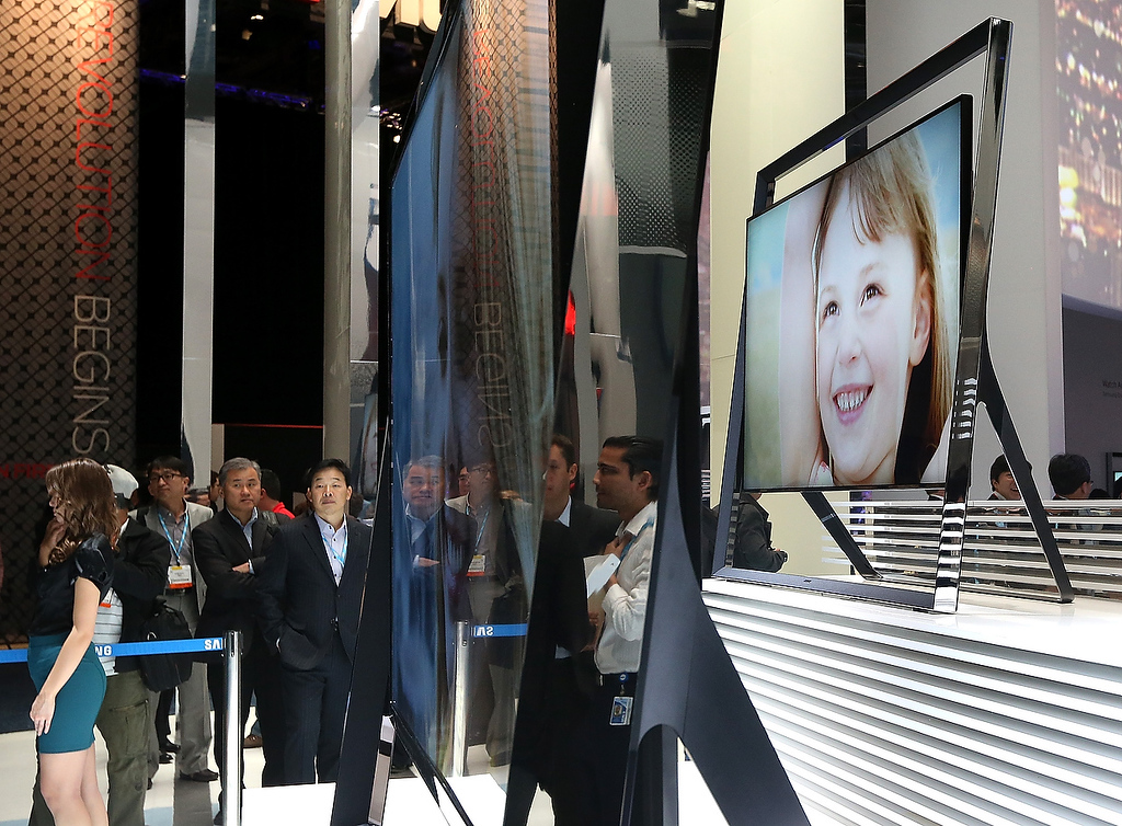 . Attendees look at a display of new large format Samsung televisions during the 2013 International CES at the Las Vegas Convention Center on January 8, 2013 in Las Vegas, Nevada. (Photo by Justin Sullivan/Getty Images)