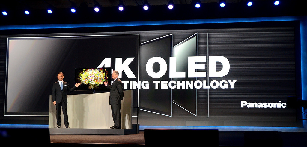 . Panasonic\'s incoming president and chief executive Kazuhiro Tzuga (L) and CEO North America Joe Taylor introduce the new 4Kn OLED TV at the 2013 International Consumer Electronics Show in Las Vegas on January 8, 2013. (JOE KLAMAR/AFP/Getty Images)