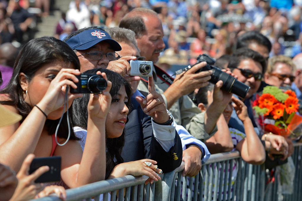 . Friends and family snap pictures of graduates during the 2014 Saint Mary\'s College commencement ceremony in Moraga, Calif., on Saturday, May 24, 2014. A total of 758 students graduated making this the largest graduating class in school history. (Jose Carlos Fajardo/Bay Area News Group)