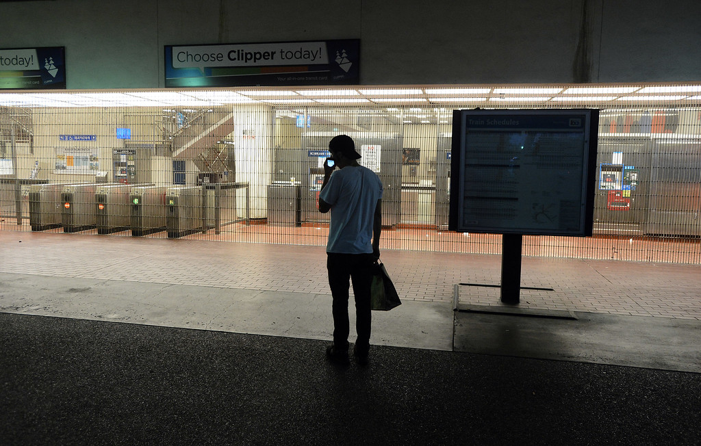 . Matt Navarro arrives to find the MacArthur BART station closed in Oakland, Calif. on Monday, July 1, 2013. (Kristopher Skinner/Bay Area News Group)