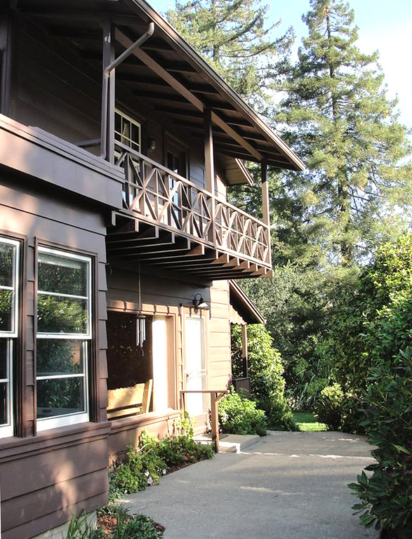 . The south side of the 1937 Berkeley Hills cabin owned by Jennifer Thomas and Rich Meyer before its 2012 remodel.The upper X bracing rail design was low and not to code, but it was used as an inspiration in the redesign for a porch off the Master Suite on the west side, with a view across the bay of San Francisco. Gustave Carlson Design photo.