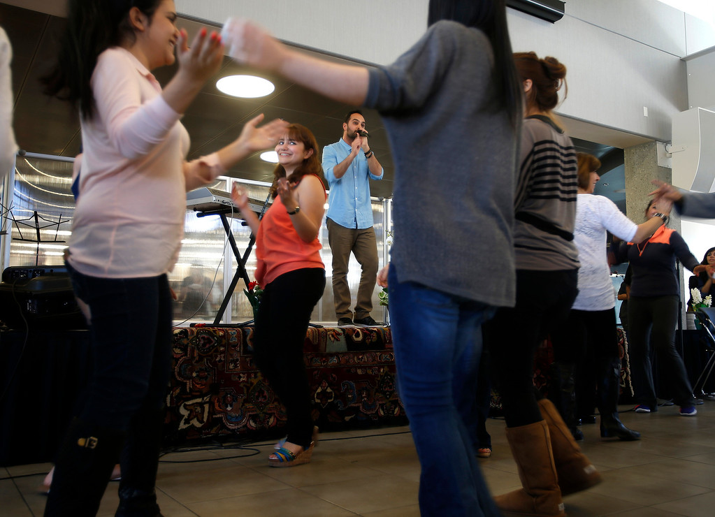 . Audience members dance as Amir London performs during the West Valley College 6th Annual Persian New Year Celebration at the college in Saratoga, Calif. on Monday, March 10, 2014.  (Nhat V. Meyer/Bay Area News Group)