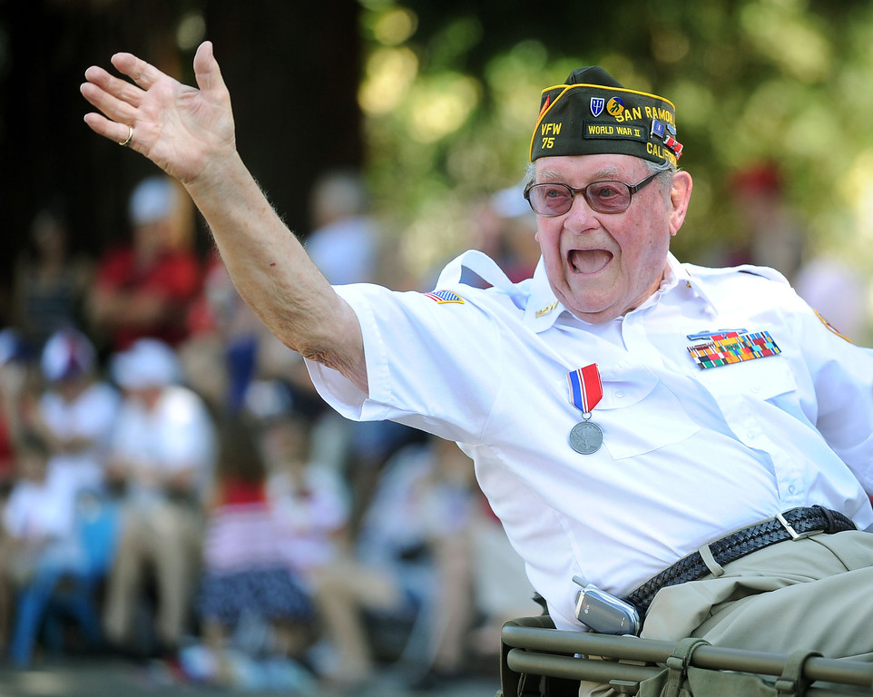 . World War II veteran Rob Crooker, 90, of Danville, waves to the crowd from the back of a vintage Jeep during the 4th of July Parade in Danville, Calif., on Thursday, July 4, 2013. The parade, sponsored by the Kiwanis Club of San Ramon Valley, features about 120 entries with an estimated 40,000 spectators attending. (Doug Duran/Bay Area News Group)