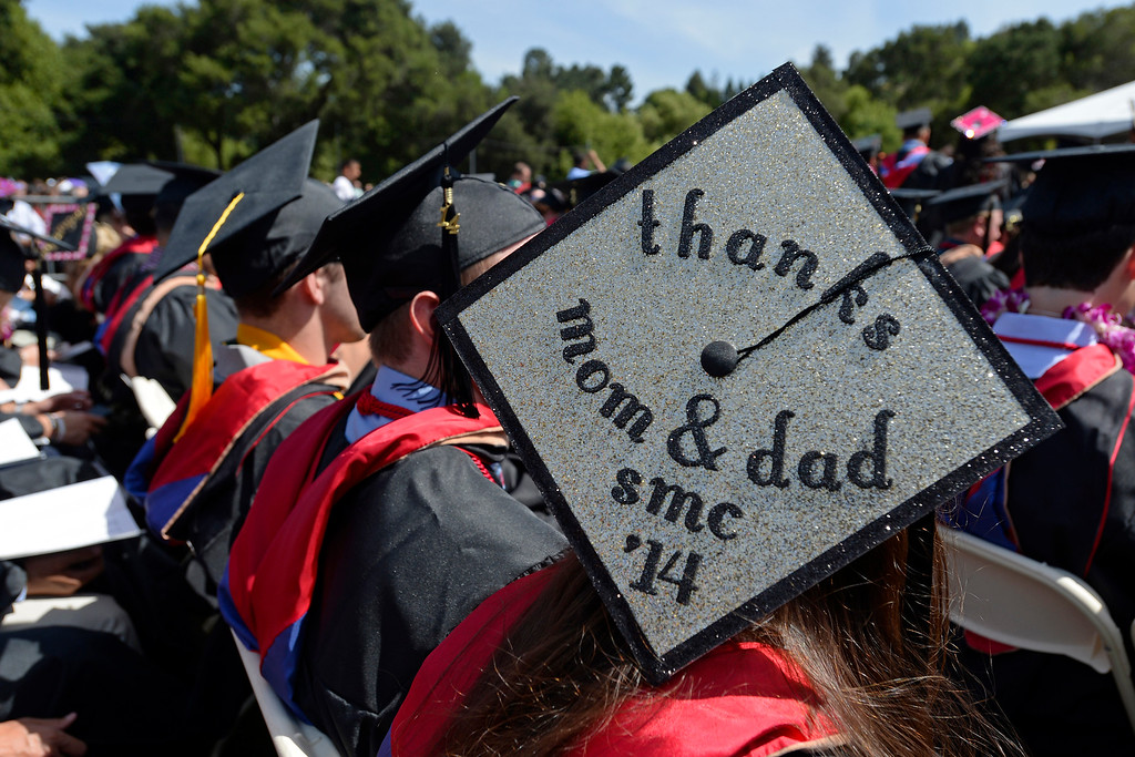 . Ena Jezildzic, of Sacrmento, displays a message to her parents on her cap during the 2014 Saint Mary\'s College commencement ceremony in Moraga, Calif., on Saturday, May 24, 2014. A total of 758 students graduated making this the largest graduating class in school history. (Jose Carlos Fajardo/Bay Area News Group)