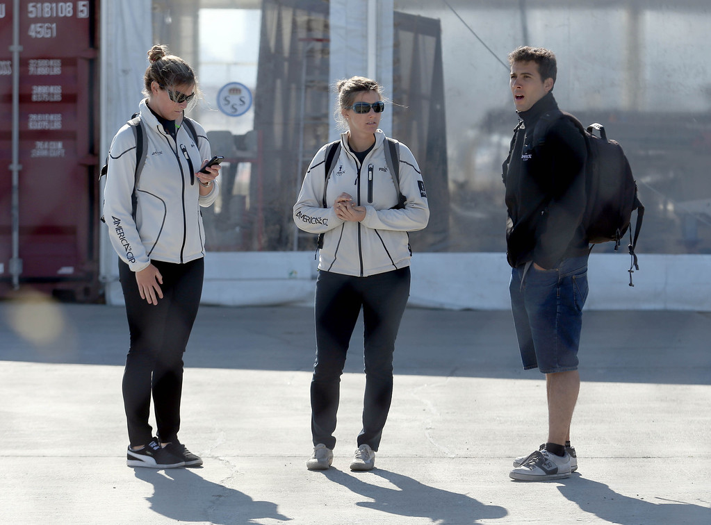 . America\'s Cup personnel, including photographer Javier Salinas, right, wait for Artemis Racing Chief Executive Officer Paul Cayard to speak to the media during a short press conference at the Artemis Racing headquarters at the former Alameda Naval Air Station in Alameda, Calif., on Thursday, May 9, 2013. (Jane Tyska/Bay Area News Group)