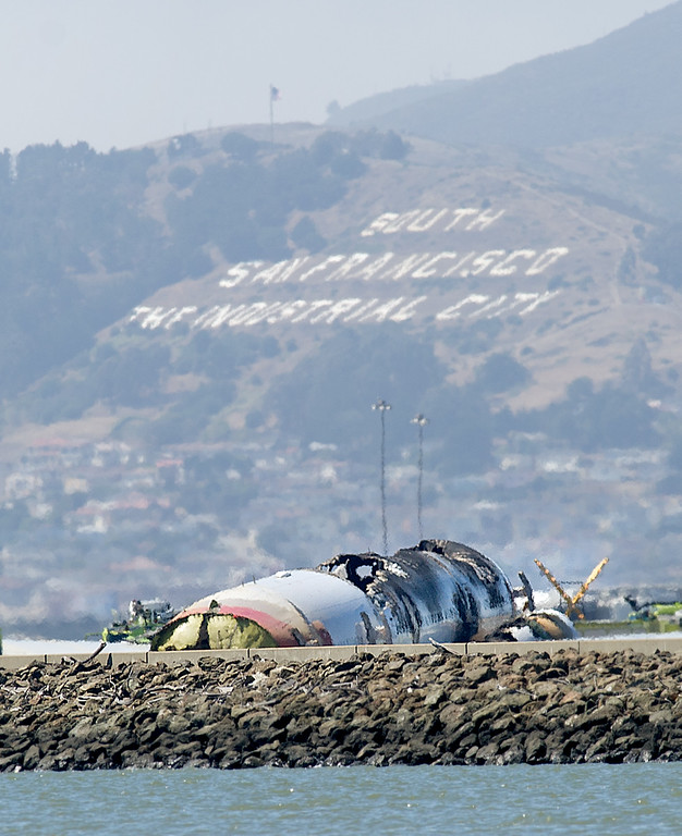 . The wreckage of Asiana Flight 214 rests at San Francisco International Airport after it crashed on Saturday, July 6, 2013, in San Francisco. (AP Photo/Noah Berger)