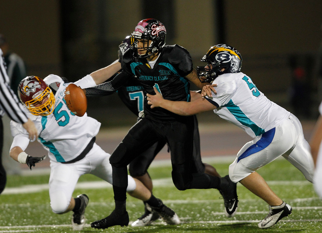 . The North\'s Tom Bucka and Dominic Luca tackle South quarterback Isaiah Hardy in the second quarter of the Literacy All-Star high school football game at San Jose City College in San Jose, Calif. on Saturday, Jan. 26, 2013. (Jim Gensheimer/Staff)