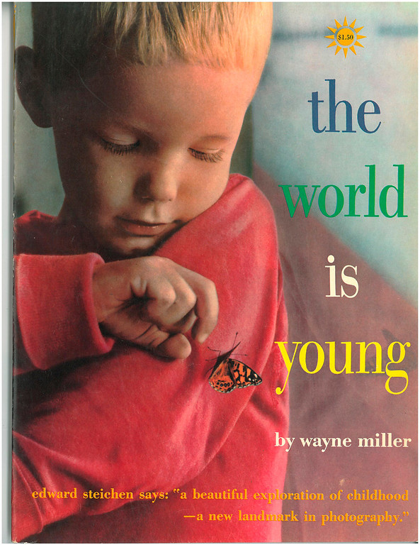 ". This undated photo shows the cover of ""The World Is Young,\"" a book published in 1958 by renowned American photographer Wayne F. Miller. Miller, who produced some of the most indelible combat images of World War II and created a ground-breaking series of portraits chronicling the lives of black Americans in Chicago, died Wednesday, May 22, 2013 at age 94. Miller served with an elite Navy unit in the Pacific and took some of the first pictures of Hiroshima, Japan, after it was devastated by the first atomic bomb.  He returned home to his native Chicago and spent two years on the city\'s South Side capturing the experiences of black residents. (AP Photo)"