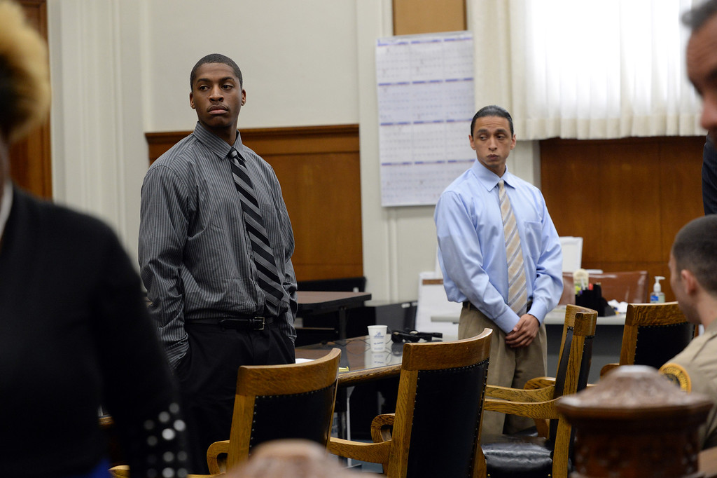 . Defendants Marcelles Peter, left, and Jose Montano, right, stand as a jury enters the courtroom at the Wakefield-Taylor courthouse in Martinez, Calif., on Thursday, July 18, 2013. Two separate verdicts were read in the richmond High gang rape trials Marcelles Peter and Jose Montano with Judge Barbara Zuniga presiding. Juries in both cases brought back guilty verdicts. (Dan Honda/Bay Area News Group)