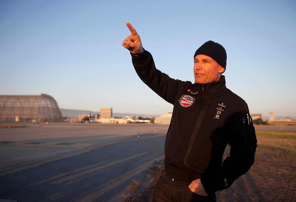. Pilot Bertrand Piccard waits for the Solar Impulse, the experimental airplane, to land after a test flight at Moffett Airfield in Mountain View, Calif. Friday morning April 19, 2013.  (Patrick Tehan/Staff)