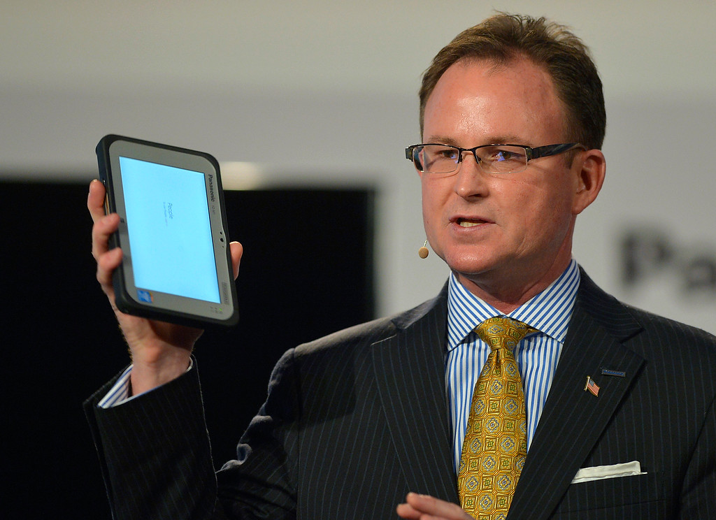 """. Rance Poehler, president of Panasonic Company of North America, shows off the new 7\"""" Toughpad FZ-M1 tablet during the Panasonic news conference at the 2014 International Consumer Electronics Show Monday, Jan. 6, 2014, in Las Vegas. (AP Photo/Jack Dempsey)"""