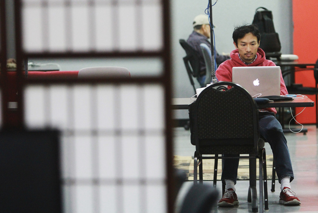 . Hacker Dojo member Ko Ohashi works on his computer during the grand opening of the new Hacker Dojo, a community center for startups, at 599 Fairchild Drive in Mountain View on Wednesday, Feb. 27, 2013. Hacker Dojo faced possible closure after city officials mandated the group bring the 140 S. Whisman Road warehouse it was originally in up to code. The group moved to its new Fairchild Drive home, about five minutes away. For more information about Hacker Dojo, visit http://www.hackerdojo.com. (Kirstina Sangsahachart/ Daily News)