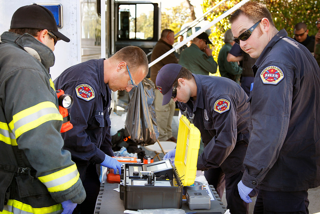 . The Santa Clara County Fire Department, test for explosive materials at Everett Basham\'s house on Humbolt Ave., in Santa Clara, Calif. on Wednesday, Feb. 13, 2013.   (LiPo Ching/Staff)