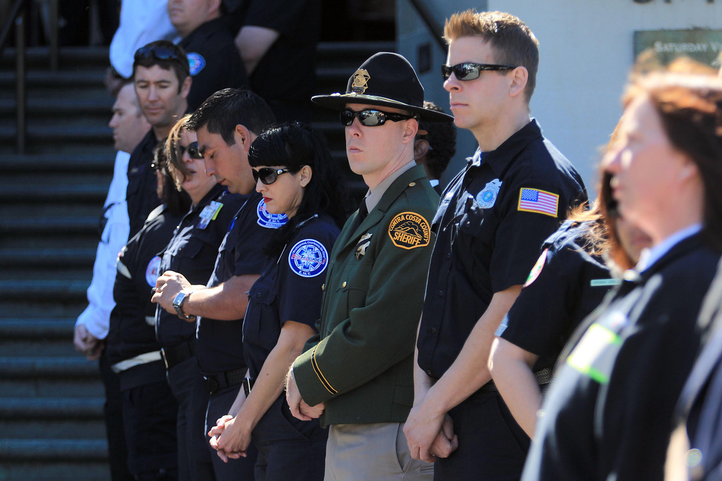 . Police, fire and paramedics from multiple Bay Area agencies attend funeral services for Santa Clara paramedic Quinn Boyer, 34, of Dublin, at St. Theresa Catholic Church in Oakland, Calif., on Tuesday, April 16, 2013.  (Jane Tyska/Staff)