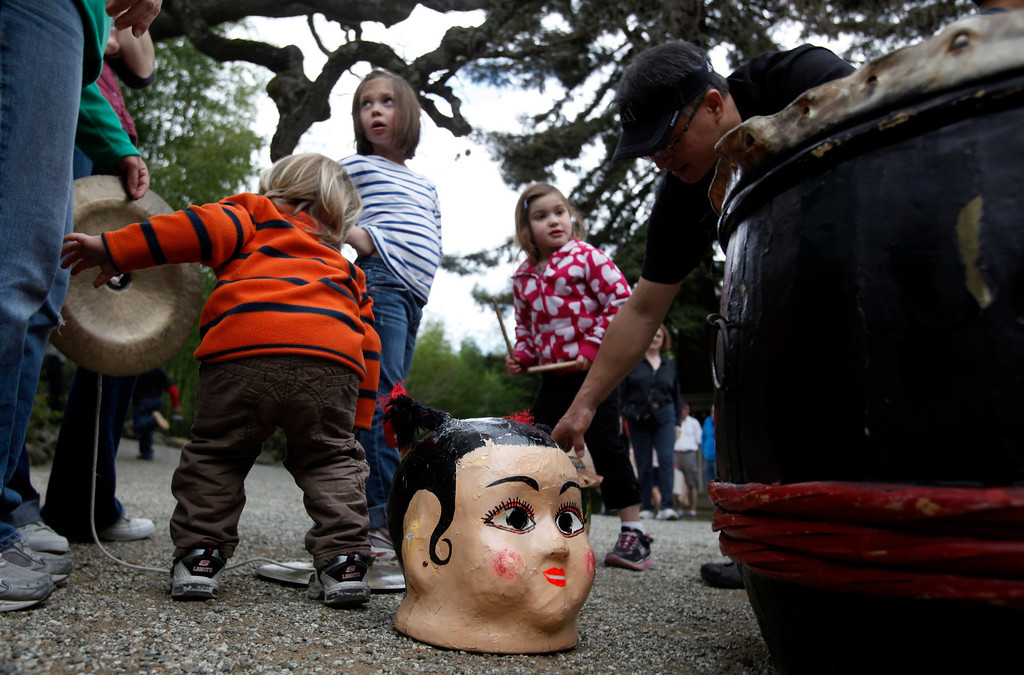 ". Young visitors mingle among the props brought by the Asian Cultural Dance Troupe to Hakone Estate and Gardens where a Lunar New Year of the Snake festival was hosted with a ""Chinese Village Fair\"" on Sunday afternoon, March 3, 2013 in Saratoga, Calif. (Karl Mondon/Staff)"