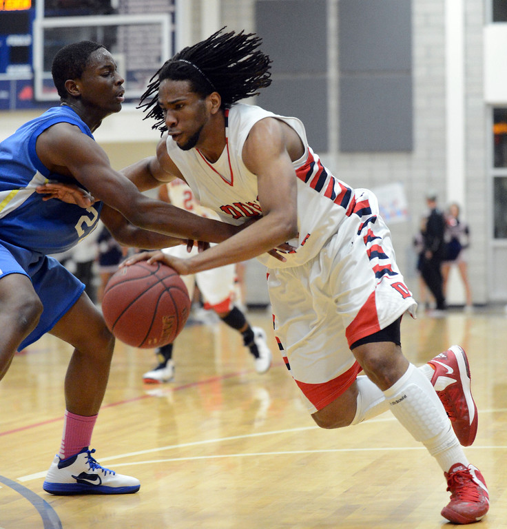 . Mt. Eden High\'s Eghosa Edogun (21) left, tries to block Dublin High\'s Jamir Andrews (4) in the first period of their NCS Division II boys basketball semifinal game in Dublin, Calif., on Wednesday, Feb. 27, 2013. Dublin High went on to win the game 85-53. (Doug Duran/Staff)
