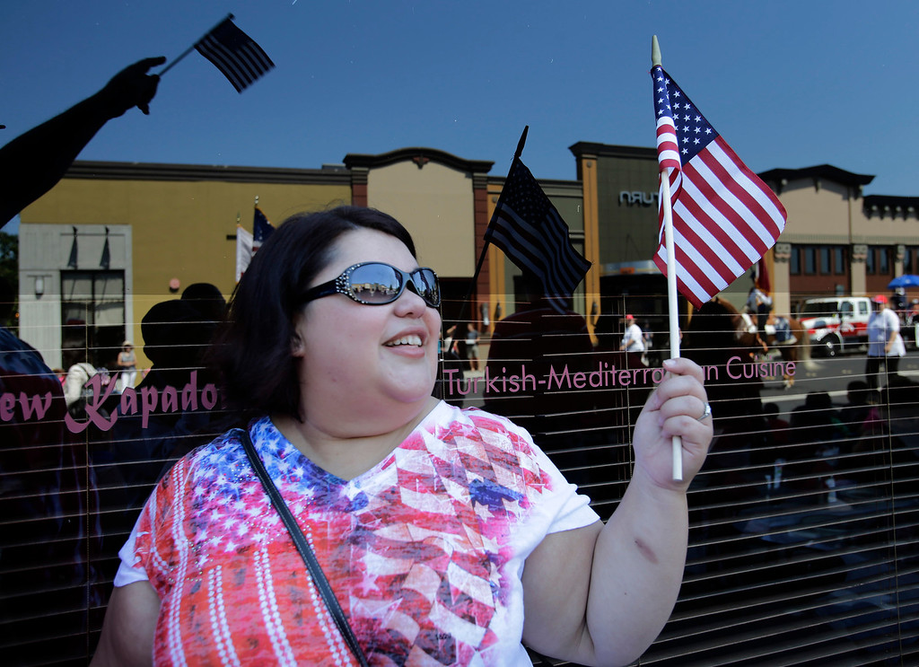 . Rosie Calhoun cheers on the annual Fourth of July parade along Winslow St. in Redwood City, Calif. on Thursday, July 4, 2013. Considered the largest Independence Day parade in Northern California, it is celebrating its 75th year. (Gary Reyes/Bay Area News Group)
