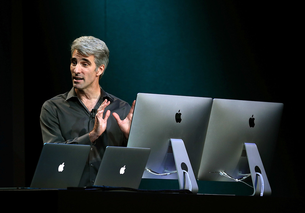 . Apple Senior Vice President of Software Engineering Craig Federighi speaks during an Apple announcement at the Yerba Buena Center for the Arts on Oct. 22, 2013 in San Francisco, California. The tech giant is expected to announce its new iPad 5, iPad mini 2, OS X Mavericks and possibly a new retina MacBook Pro.  (Justin Sullivan/Getty Images)