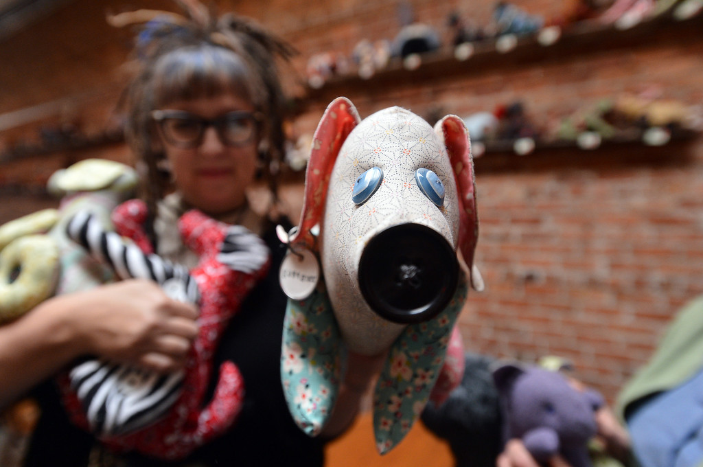 . Madeline Stanionis, who along with Alice Worland is behind the Scrapyard Dogs effort to raise money for local charities, shows one of their creations at the Lanesplitter Pizza location in Berkeley, Calif. on Monday, Jan. 28, 2013. (Kristopher Skinner/Staff)