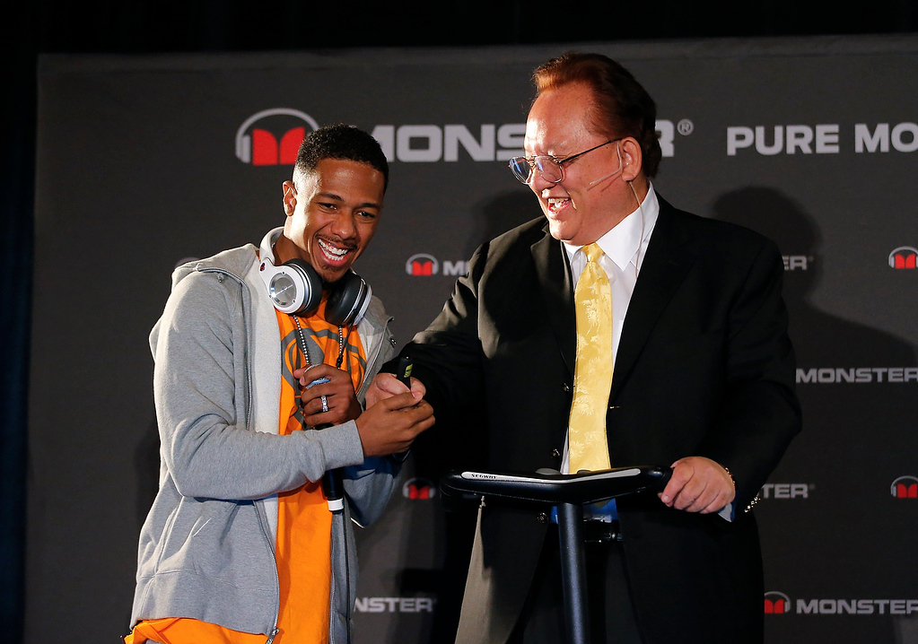 . Recording artist Nick Cannon, left, shakes hands with Monster CEO Noel Lee during a new conference at the International Consumer Electronics Show in Las Vegas, Monday, Jan. 7, 2013. (AP Photo/Jae C. Hong)