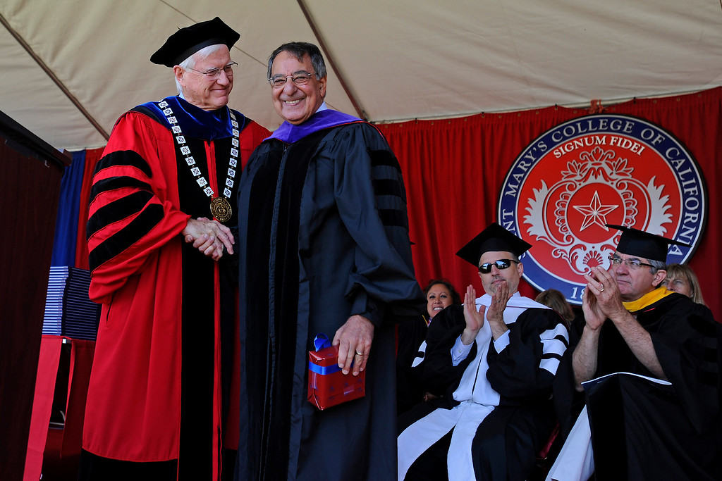 . Saint Mary\'s College president James A. Donahue shakes hands with former Secretary of Defense Leon Panetta after presenting him with a gift following his commencement address during the 2014 Saint Mary\'s College commencement ceremony in Moraga, Calif., on Saturday, May 24, 2014. A total of 758 students graduated making this the largest graduating class in school history. (Jose Carlos Fajardo/Bay Area News Group)