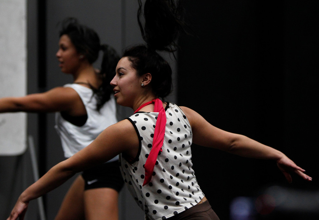 . Marissa Dutra, right, and Marissa Gomez dance during their audition during a casting call for Great America theme park for their various characters and dancers in Hall Todd Theatre at San Jose State University on Wednesday, Feb. 6, 2013.  (Nhat V. Meyer/Staff)