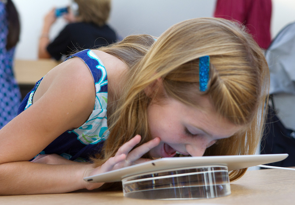 . Hannah Krause, 7, plays with an iPad at the redesigned Apple Store at the Stanford Shopping Center in Palo Alto, Calif., on Saturday, Sept. 7, 2013.  (LiPo Ching/Bay Area News Group)