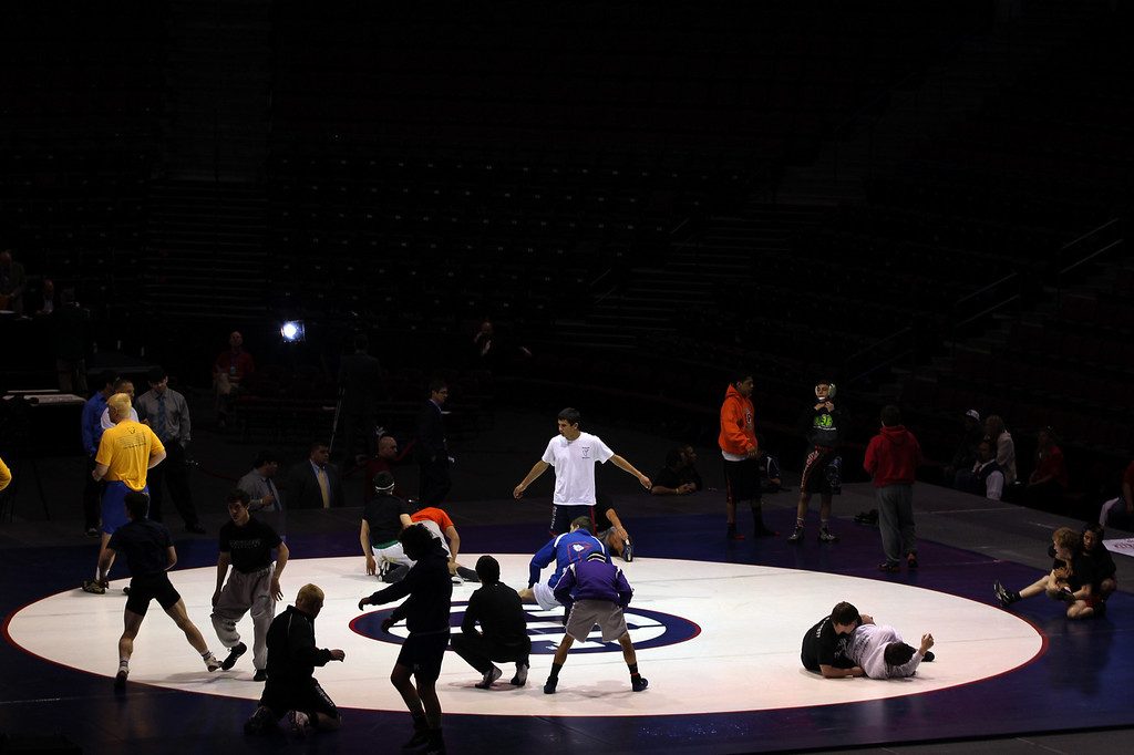 . Wrestlers warm up prior to the start of the final round during the California Interscholastic Federation wrestling championships in Bakersfield, Calif., on Saturday, March 2, 2013. (Anda Chu/Staff)