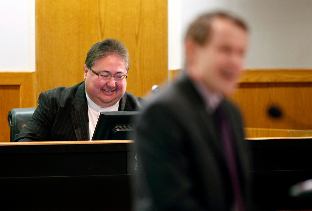 . As Supervisor Ken Yeager, president of the County of Santa Clara Board of Supervisors, makes a few light-hearted jokes before delivering the 2013 State of the County Address in the Board Chambers, past board president George Shirikawa, Jr. shares a laugh on Tuesday Jan. 29, 2013 in San Jose, Calif. (Karl Mondon/Staff)