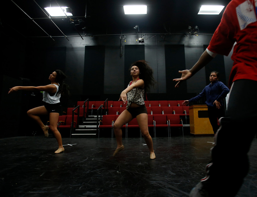 . Desi Hyter, far right, hand, choreographer for Great America, leads Marissa Gomez, far left, Marissa Dutra, center, and Angelique Gorospe, right, during a dance audition during a casting call for Great America theme park for their various characters and dancers in Hall Todd Theatre at San Jose State University on Wednesday, Feb. 6, 2013.  (Nhat V. Meyer/Staff)
