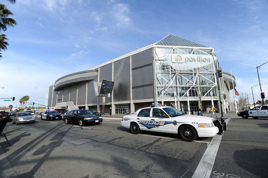 . Police officers representing many agencies begin to arrive at the HP Pavilion in San Jose, Calif., on Thursday, March 7, 2013. (Dan Honda/Bay Area News Group)