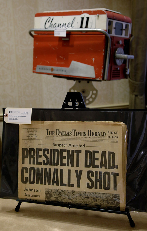 """. In this Tuesday, Oct. 22, 2013 photo a copy of the final edition of The Dallas Times Herald from the afternoon of November 22, 1963 proclaims the assassination of  President John Fitzgerald Kennedy. The paper along with a circa 1960\'s General Electric television broadcast camera owned by KTVT television in Dallas, Texas are part of a themed memorabilia auction \""""Camelot: Fifty Years After Dallas\"""" at the Omni Parker House hotel in Boston. The television camera was used by KTVT to record the shooting of Lee Harvey Oswald by Jack Ruby in the basement of the Dallas Police Station on Nov. 24, 1963. (AP Photo/Stephan Savoia)"""