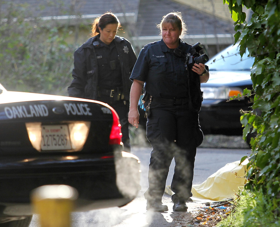 . Oakland police crime scene technicians investigate after a man was found dead of gunshot wounds on Canon Avenue near Dimond Park in Oakland, Calif. on Friday, Jan. 11, 2013. (Jane Tyska/Staff)