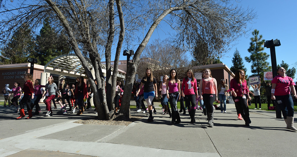 ". Women dance on the Diablo Valley College campus during a ""One Billion Rising\"" event at the college in Pleasant Hill, Calif. on Thursday, Feb. 14, 2013. (Kristopher Skinner/Staff)"