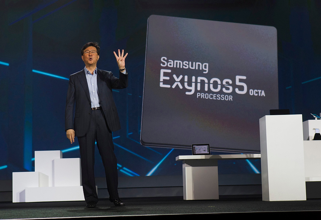 . Stephen Woo, president of Device Solutions Business for Samsung Electronics, talks about the new Samsung Exynos 5 Octa processor during a keynote address at the Consumer Electronics Show (CES) in Las Vegas January 9, 2013. The processor is faster and uses less power than Samsung\'s previous models, Woo said. (REUTERS/Steve Marcus)
