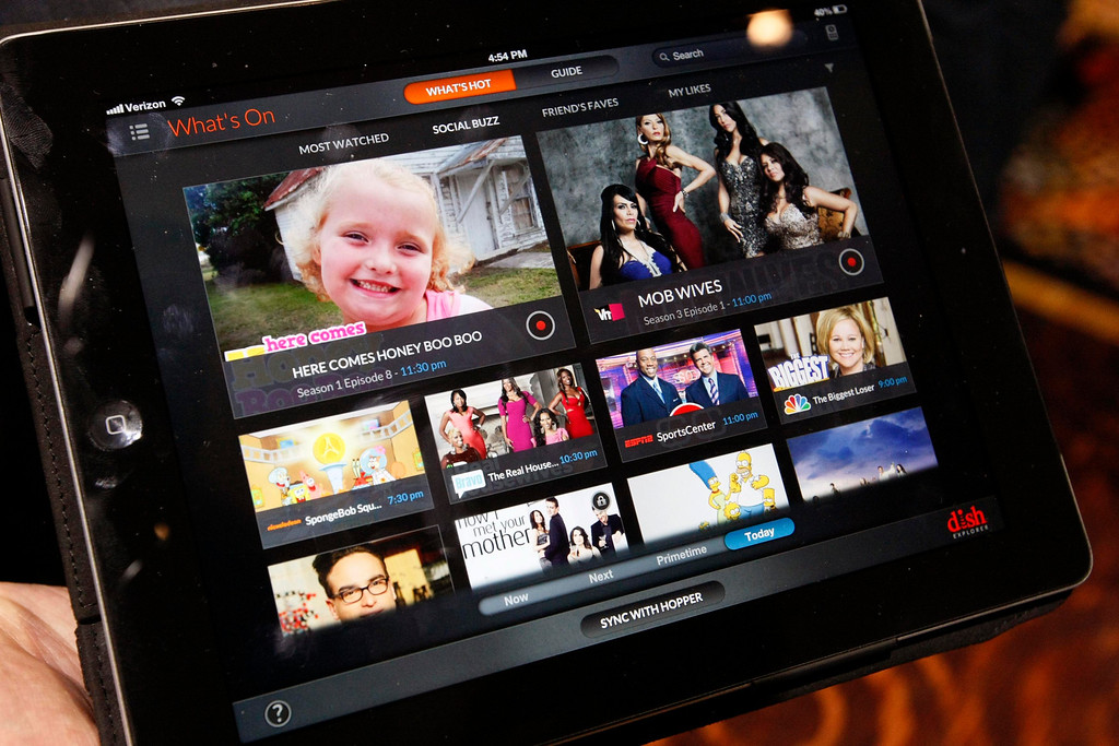 . The start screen for the Dish Explorer app is seen on an iPad at the opening press event of the Consumer Electronics Show (CES) in Las Vegas on Jan. 6, 2013. The software announced Sunday at CES, allows a Dish customer to use a mobile device to serve as a remote control, and recommends programming based on real-time TV viewing and social media trends.  (REUTERS/Rick Wilking)