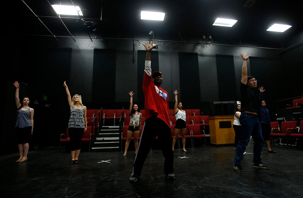 . Desi Hyter, choreographer for Great America, leads a dance audition during a casting call for Great America theme park for their various characters and dancers in Hall Todd Theatre at San Jose State University on Wednesday, Feb. 6, 2013.  (Nhat V. Meyer/Staff)