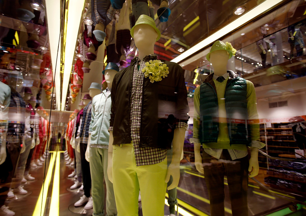 . A mannequin wearing mens clothes rotates in a glass display case on the Men\'s floor, lower level, at Uniqlo clothing store on Powell St. in downtown San Francisco, Calif. on Thursday, Jan. 17, 2013.  They opened their store in San Francisco in October 2012.  (Nhat V. Meyer/Staff)