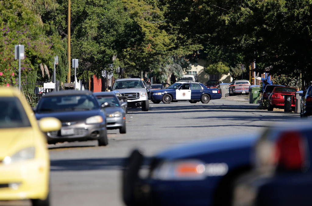 . The neighborhood at Diana Lane and Story Rd. is surrounded by the San Jose Police Depart as they search for a gunman who tried to rob a check-cashing store in East San Jose, Calif. on Thursday, Aug. 1, 2013.  (Gary Reyes/Bay Area News Group)