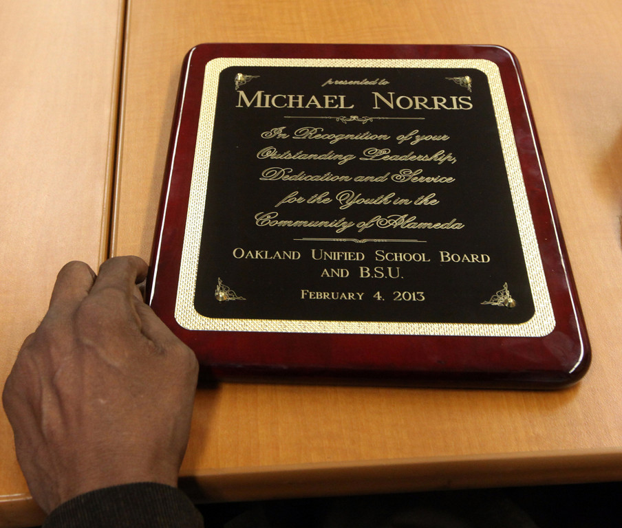 . A plaque honoring former A\'s pitcher Michael Norris is given to him at Skyline\'s annual Black History Assembly at Skyline High School in Oakland, Calif. on Monday, Feb. 4, 2013. (Laura A. Oda/Staff)