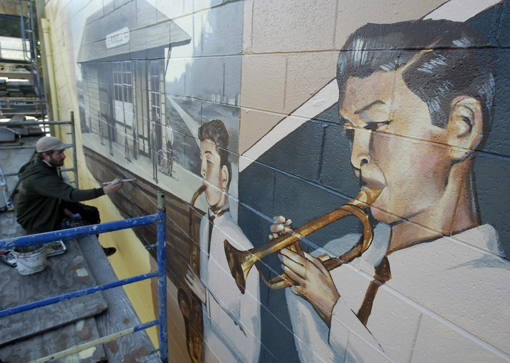 . Artist Josh Powell paints a section of his new mural along A Street at Maple Court in Hayward, Calif. Friday Jan. 13, 2012. The mural joins other murals painted by Powell and many other local artists throughout the City of Hayward. (Anda Chu/Staff Archives)