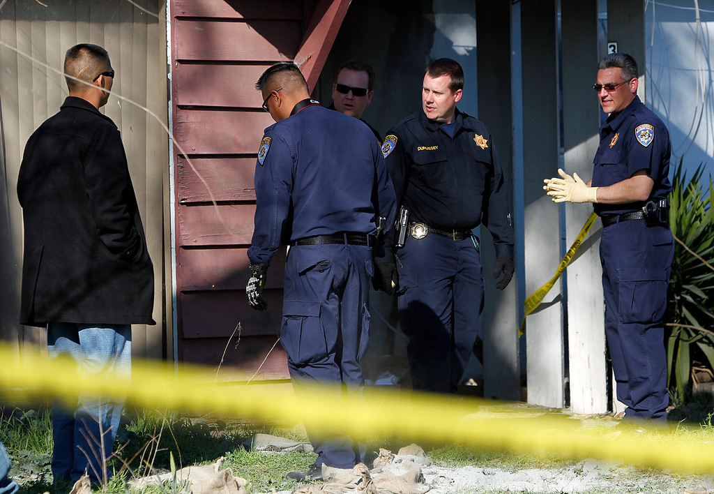 . Members of  the California Highway Patrol and other law enforcement officers confer in front  Everett Basham\'s house on 3133 Humbolt Ave., during the search for explosive materials in Santa Clara, Calif. on Wednesday, Feb. 13, 2013.   (LiPo Ching/Staff)