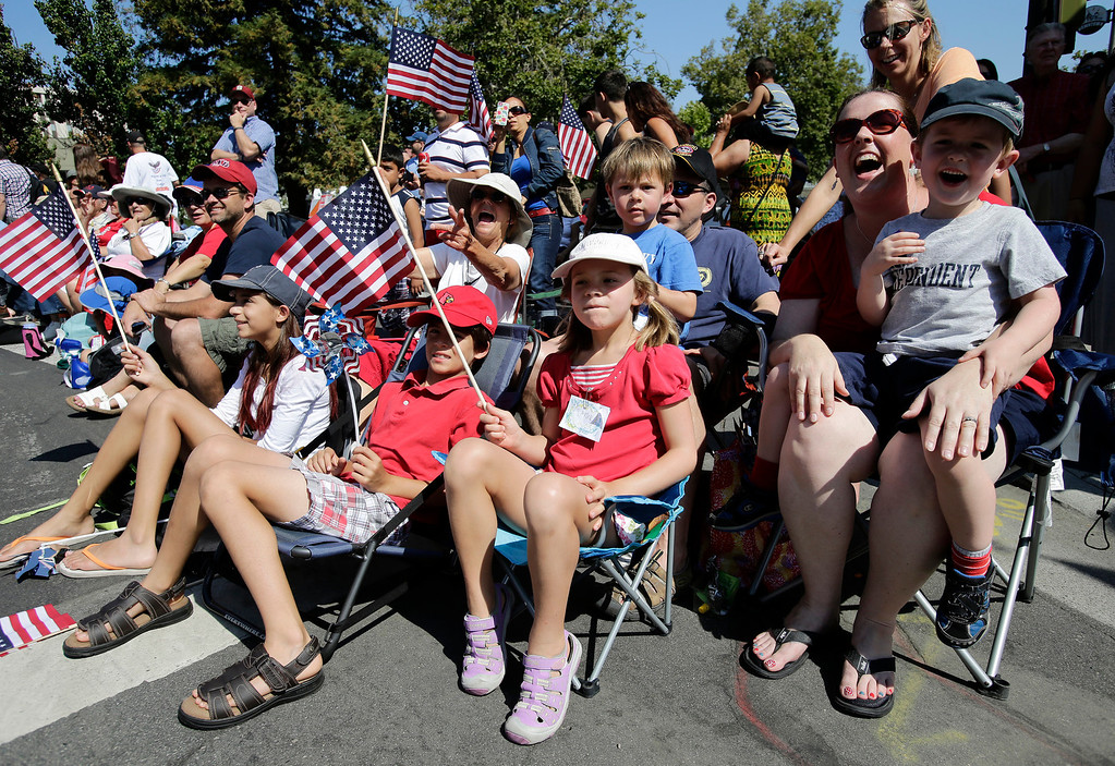. The combined Rice, Homan and Duncan families from Sunnyvale came to see the annual Fourth of July parade in Redwood City, Calif. on Thursday, July 4, 2013. Considered the largest Independence Day parade in Northern California, it is celebrating its 75th year. (Gary Reyes/Bay Area News Group)