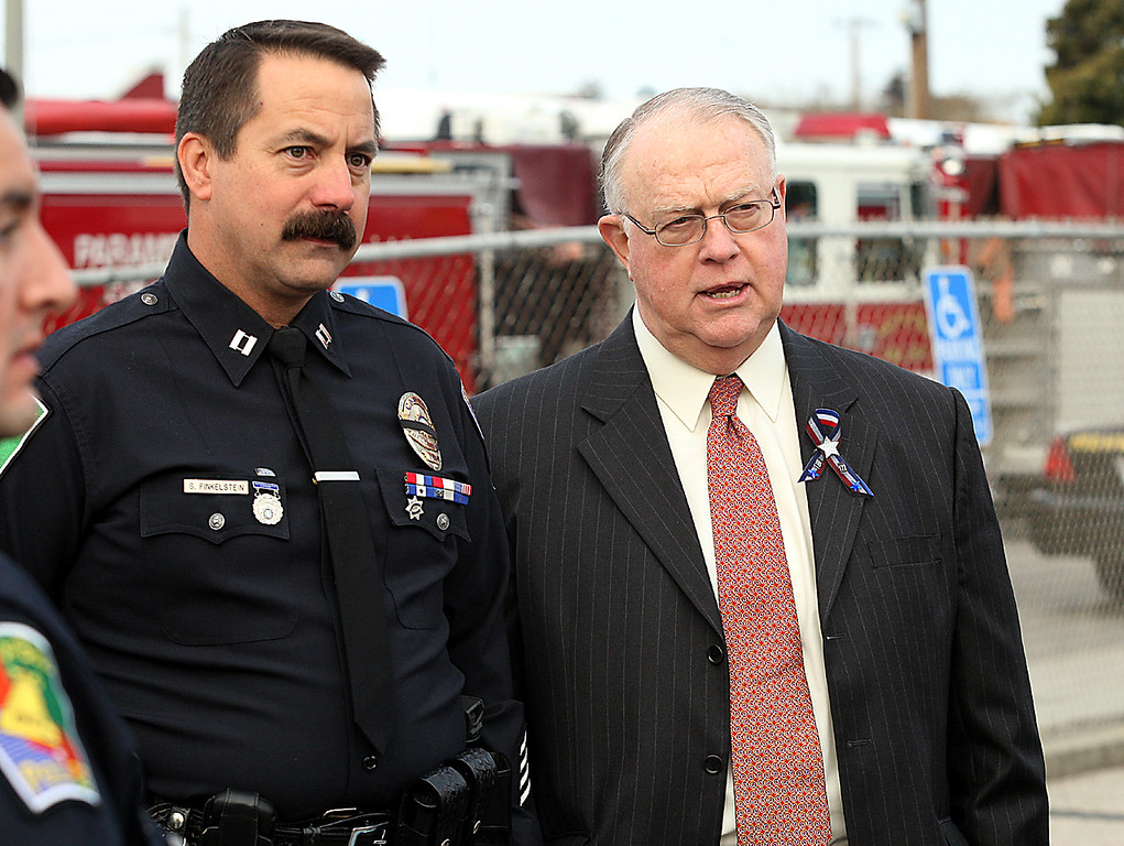 . Former Santa Cruz Police Chief Steve Belcher, right, waits to join the funeral procession with Bell Police Department Capt. Steven Finkelstein Thursday, March 7, 2013, at the Santa Cruz Boardwalk parking lot. (Dan Coyro/Santa Cruz Sentinel)