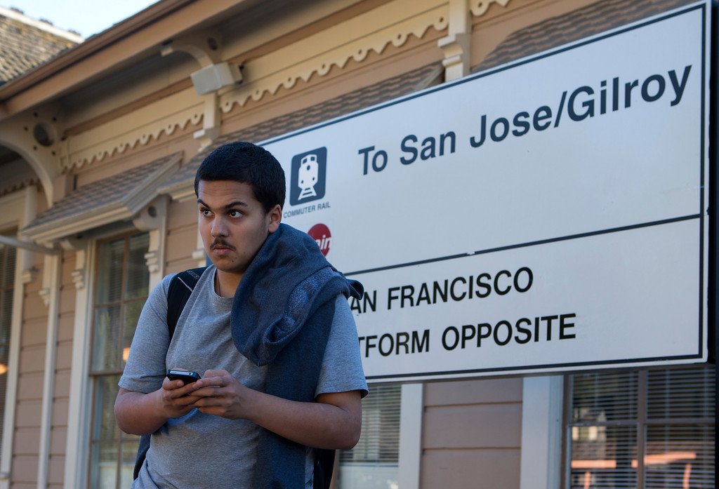 . Kieran Rege, 15, waits for the train in Menlo Park, Calif., on Wednesday, Jan. 20, 2013.  Diagnosed with autism when he was 3, Kieran is one of a growing number of children that have lost their diagnosis.Through behavioral, speech and dietary interventions, the Palo Alto teenager is now bright, sociable and confident. (John Green/Staff)