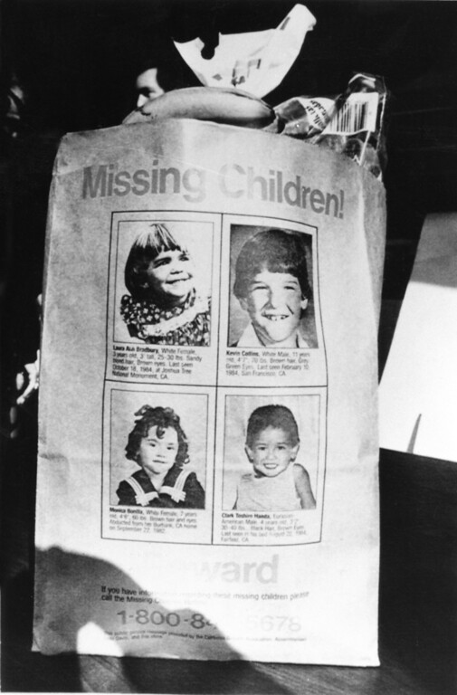 . A paper bag bearing the photos of Laura Bradbury, Kevin Collins, Monica Bonilla and Clark Toshiro Handa, four missing children, is displayed during a Wednesday, Jan. 31, 1985, press conference announcing the latest efforts by the California Grocers Association, state Assemblyman Gray Davis (D, Sherman Oaks) and various California grocery stores to locate missing children. (AP Photo/Barbara Crownover)